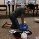Kim Adams of Cable practices CPR chest compressions