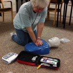 Linda McClain of West Liberty practices CPR chest compressions