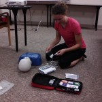 Heather Bumbalough of West Liberty practices placing AED pads on a manikin